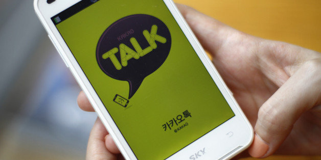In this Aug. 20, 2012 photo, a woman opens Kakao Talk, a South Korean mobile messaging app with more than 60 million users, on her smartphone in Seoul, South Korea. A handful of smartphone apps that began as basic instant messaging services have amassed several hundred million users in Asia in just a couple of years, mounting a challenge to the popularity of online hangouts such as Facebook as they branch into games, e-commerce, celebrity news and other areas. (AP Photo/Hye Soo Nah)
