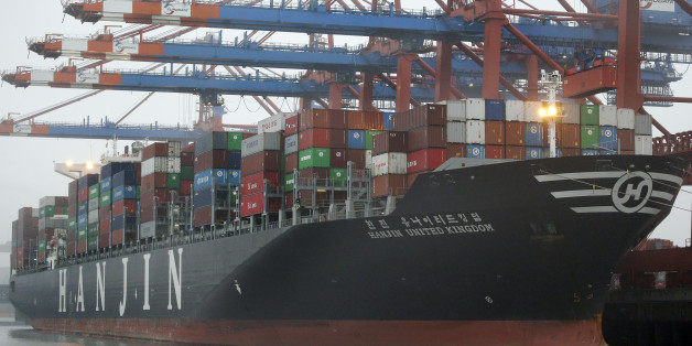 The 'United Kingdom' vessel of the Hanjin shipping company is stevedored at the harbour in Hamburg, Germany, Wednesday, Oct. 29, 2014. (AP Photo/Michael Sohn)