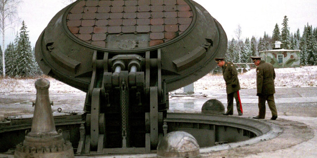 Russian military officials, no names given, look into an open silo of an intercontinental ballistic Topol-M missile at an undisclosed location in Russia in this 2001 photo.  Russia has deployed a fresh batch of its top-of-the-line strategic nuclear missiles after a break caused by a funding shortage, said military officials on Monday, Dec. 22, 2003. (AP Photo)