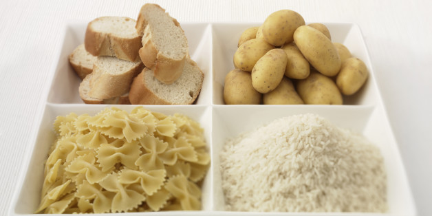 Close up of sectioned plate with bread, potatoes, rice and pasta