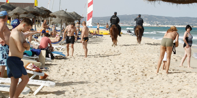 Tourist police officers patrol the beach in Hammamet, Tunisia, June 18, 2016. REUTERS/Zoubeir Souissi
