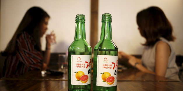 Bottles of fruit flavoured and low-alcohol soju are seen in this picture illustration at a pub in Seoul, South Korea, September 9, 2015. Professional women are driving a change in the way beverage companies look at South Korea, which hard-drinking men have made Asia's biggest alcohol consuming country on a per capita basis. As more women join the workforce in South Korea, a growing share of younger women are becoming regular drinkers, shifting consumption patterns in a male-dominated society where post-work drinking sessions are a staple of office life. Rising incomes and a greater interest in health also mean fewer Koreans merely seek out the cheapest way to get drunk. Picture taken September 9, 2015.  REUTERS/Kim Hong-Ji