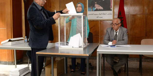 A Moroccan man casts his vote at a polling station in the capital Rabat on October 2, 2015, during an indirect vote to elect Morocco's upper chamber of parliament. The portrait on the wall shows Moroccan King Mohammed VI. AFP PHOTO / FADEL SENNA        (Photo credit should read FADEL SENNA/AFP/Getty Images)