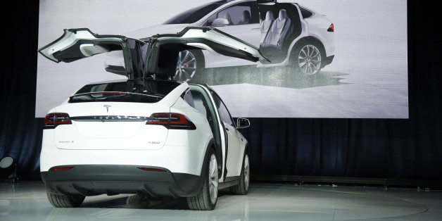 The Model X car is unveiled at the company's headquarters Tuesday, Sept. 29, 2015, in Fremont, Calif.  (AP Photo/Marcio Jose Sanchez)