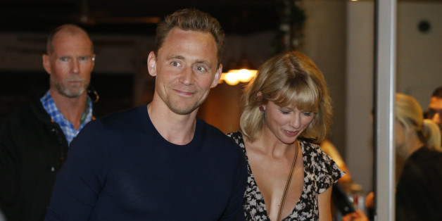 GOLD COAST, AUSTRALIA - JULY 10: (EUROPE AND AUSTRALASIA OUT) Actor Tom Hiddleston and singer Taylor Swift leave restaurant 'Gemelli Italian' in Broadbeach on the Gold Coast, Queensland. (Photo by Jerad Williams/Newspix/Getty Images)