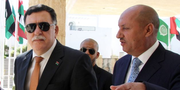 Libyan Prime Minister Fayez al-Sarraj (L) arrives for the second day of UN-brokered talks with members of the Libyan Political Dialogue to discuss power struggles and jihadist threats that are undermining stability in the oil-rich country on September 6, 2016 in Tunis. / AFP / STRINGER        (Photo credit should read STRINGER/AFP/Getty Images)