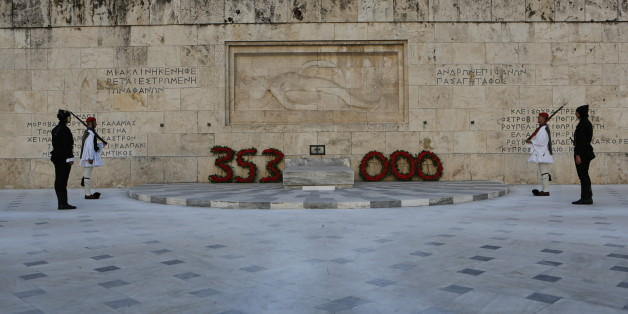SYNTAGMA SQUARE, ATHENS, ATTICA, GREECE - 2015/05/19: Four Evzones (Greek Presidential Guard), two dressed in the black traditional uniforms of Pontic soldiers stand to attention at the Tomb of the Unknown Soldier, after the wreaths that show the numbers of Greeks killed in the genocide. Greeks from the Pontus region (Black Sea) hold a commemoration ceremony for the anniversary of the Pontic genocide by the Ottoman Empire. The Pontic genocide is the ethnic cleansing of the Christian Greek population from the Pontus area in Turkey during World War I and its aftermath. (Photo by Michael Debets/Pacific Press/LightRocket via Getty Images)