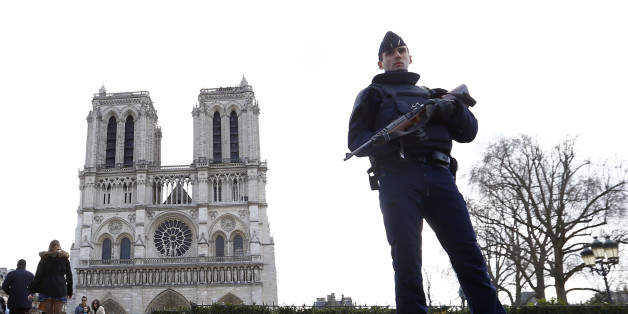 FILE - In this March 27, 2016 file photo, a French Police officer stands guards as worshipers arrive for the Easter mass at Notre Dame Cathedral, in Paris. Police officials say Wednesday Sept. 7, 2016 a terrorism investigation is under way into seven gas canisters found in a car parked near Notre Dame Cathedral in Paris. The car was discovered Sunday morning along the Seine River, with no one inside and no license plates but with the hazard lights on, the officials said Wednesday (AP Photo/Francois Mori, File)
