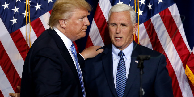 Republican presidential candidate Donald Trump, left, greets vice presidential candidate Gov. Mike Pence as he takes the stage during a campaign rally at the Phoenix Convention Center, Wednesday, Aug. 31, 2016, in Phoenix. (AP Photo/Ross D. Franklin)