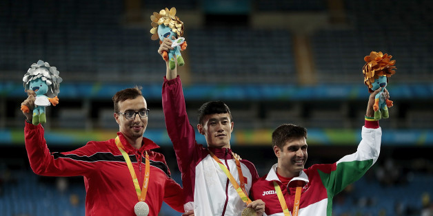 RIO DE JANEIRO, BRAZIL - SEPTEMBER 09: (L-R) Silver medalist Mahdi Afri of Morocco, gold medalist Qichao Sun of China and bronze medalist Luis Goncalves of Portugal celebrate on the podium at the medal ceremony for the Men's 400m T12 Final during day 2 of the Rio 2016 Paralympic Games at the Olympic Stadium on September 9, 2016 in Rio de Janeiro, Brazil.