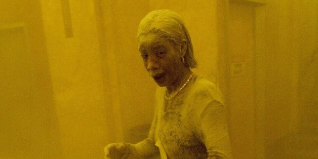 New York, UNITED STATES:  TO GO WITH AFP STORY 'Americans mark 9/11 anniversary with new questions on vulnerability' - This 11 September 2001 file photo shows Marcy Borders covered in dust as she takes refuge in an office building after one of the World Trade Center towers collapsed in New York. Borders was caught outside on the street as the cloud of smoke and dust enveloped the area.  The woman was caught outside on the street as the cloud of smoke and dust enveloped the area.  AFP PHOTO/Stan HONDA  (Photo credit should read STAN HONDA/AFP/Getty Images)