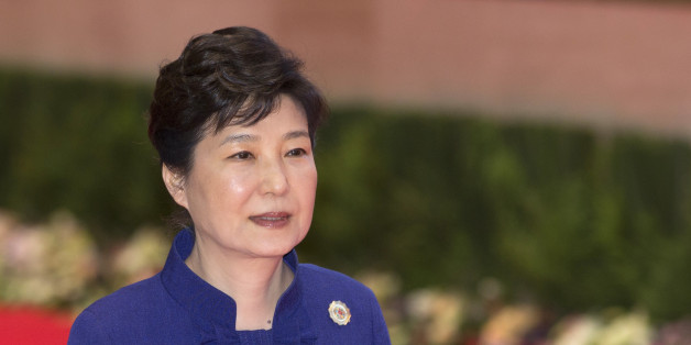 South Korea's President Park Geun-hye walks to participate in the 18th ASEAN-Republic of Korea summit, a parallel summit in the ongoing 28th and 29th ASEAN Summits at National Convention Center in Vientiane, Laos, Wednesday, Sept. 7, 2016. (AP Photo/Gemunu Amarasinghe)