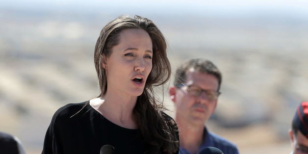 Actress and UN refugee agency envoy special envoy Angelina Jolie talks during a visit to a Syrian refugee camp in Azraq in northern Jordan on Friday, Sept. 9, 2016. She is calling on the international community to end the protracted Syrian civil war and increase support for refugees across the region. Five years into the Syrian conflict, she said brutal violence rages while the UN Security Council remains divided on a political solution. (AP Photo/Ahmad Alameen)