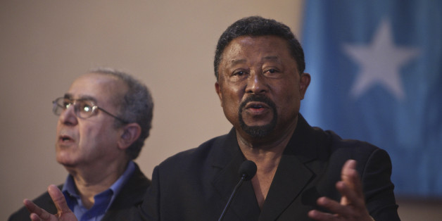 Jean Ping (R), chairman of the Commission of the African Union, speaks at a joint news conference with Somalia's President Sheikh Sharif Sheikh Ahmed (not pictured) at Villa Somalia, the complex that houses the Transitional Federal Government (TFG), in Mogadishu August 20, 2011. REUTERS/Stuart Price/AU-UN IST Photo/Handout (SOMALIA - Tags: POLITICS) FOR EDITORIAL USE ONLY. NOT FOR SALE FOR MARKETING OR ADVERTISING CAMPAIGNS. THIS IMAGE HAS BEEN SUPPLIED BY A THIRD PARTY. IT IS DISTRIBUTED, EXACT