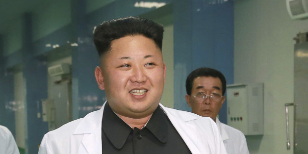North Korean leader Kim Jung Un visits the newly commissioned Kalma Foodstuff Factory in this undated photo released by North Korea's Korean Central News Agency (KCNA) in Pyongyang August 15, 2014. REUTERS/KCNA (NORTH KOREA - Tags: POLITICS FOOD) ATTENTION EDITORS - THIS PICTURE WAS PROVIDED BY A THIRD PARTY. REUTERS IS UNABLE TO INDEPENDENTLY VERIFY THE AUTHENTICITY, CONTENT, LOCATION OR DATE OF THIS IMAGE. FOR EDITORIAL USE ONLY. NOT FOR SALE FOR MARKETING OR ADVERTISING CAMPAIGNS. THIS PICTUR