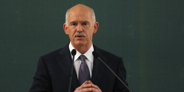 Former Greek Prime Minister George Papandreou speaks during a conference of the PASOK socialist party at Faliro, near Athens, Saturday, March 10 2012. Greece's private creditors agreed Friday to take cents on the euro in the biggest debt writedown in history, paving the way for an enormous second bailout for the country to keep Europe's economy from being dragged further into chaos. (AP Photo/Kostas Tsironis)