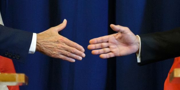 TOPSHOT - US Secretary of State John Kerry (L) and Russian Foreign Minister Sergei Lavrov shake hands at the end of a press conference closing meetings to discuss the Syrian crisis on September 9, 2016, in Geneva.The United State and Russia on Friday agreed a plan to impose a ceasefire in the Syrian civil war and lay the foundation of a peace process, US Secretary of State John Kerry said. / AFP / FABRICE COFFRINI        (Photo credit should read FABRICE COFFRINI/AFP/Getty Images)