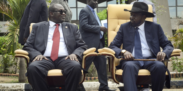 FILE - In this Friday, April 29, 2016 file photo, South Sudan's then First Vice President Riek Machar, left, looks across at President Salva Kiir, as the two sit to be photographed following the first meeting of a new transitional coalition government, in the capital Juba, South Sudan. According to reports from victims which have come to light Monday Aug. 15, 2016, South Sudanese troops, fresh from winning a battle against opposition forces in the capital, Juba, on July 11, 2016,  went on a nearly four-hour rampage through a residential compound popular with foreigners, and the U.N. peacekeeping force stationed nearby are accused of refusing to respond to desperate calls for help. (AP Photo/Jason Patinkin, File)