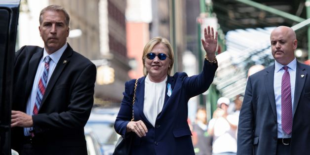 US Democratic presidential nominee Hillary Clinton waves to the press as she leaves her daughter's apartment building after resting on September 11, 2016 in New York. Clinton departed from a remembrance ceremony on the 15th anniversary of the 9/11 attacks after feeling 'overheated,' but was later doing 'much better,' her campaign said. / AFP / Brendan Smialowski        (Photo credit should read BRENDAN SMIALOWSKI/AFP/Getty Images)