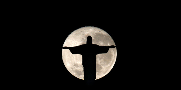 The full moon is pictured behind the Christ the Redeemer statue ahead of the 2016 Rio Olympic games in Rio de Janeiro, Brazil, July 19, 2016. REUTERS/Bruno Kelly     TPX IMAGES OF THE DAY