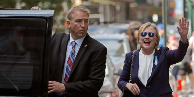 """U.S. Democratic presidential candidate Hillary Clinton leaves her daughter Chelsea's home in New York, New York, United States September 11, 2016, after Clinton left ceremonies commemorating the 15th anniversary of the September 11 attacks feeling """"overheated.""""  REUTERS/Brian Snyder/File Photo"""