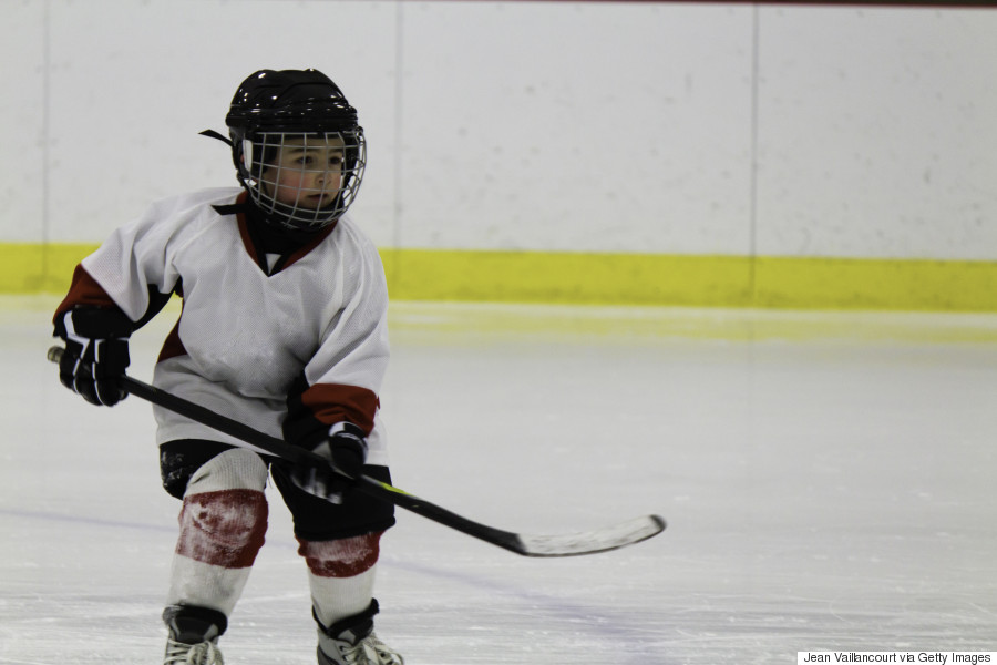 kid playing hockey