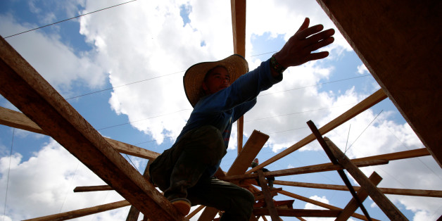 A Colombian from the Revolutionary Armed Forces of Colombia (FARC) works on a platform to prepare accommodation for an upcoming congress ratifying a peace deal with the government, near El Diamante in Yari Plains, Colombia, September 9, 2016. Picture taken September 9, 2016.  REUTERS/John Vizcaino