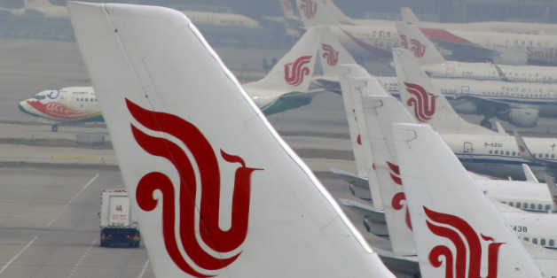 Flights of Air China are parked on the tarmac of Beijing Capital International Airport in Beijing, China, March 28, 2016. REUTERS/Kim Kyung-Hoon/File Photo