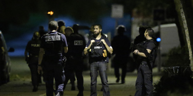 French policemen take part in a police raid in Boussy-Saint-Antoine near Paris, France, September 8, 2016. French police investigating the abandonment of a car packed with gas cylinders near Paris's Notre Dame cathedral last Saturday, arrested three women on Thursday evening, in Boussy-Saint-Antoine, some 30 km south-east of Paris. REUTERS/Christian Hartmann