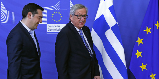 Greek Prime Minister Alexis Tsipras (L) is welcomed by European Commission President Jean-Claude Juncker (R) ahead of a meeting at the EU Commission headquarters in Brussels, Belgium February 17, 2016. REUTERS/Yves Herman