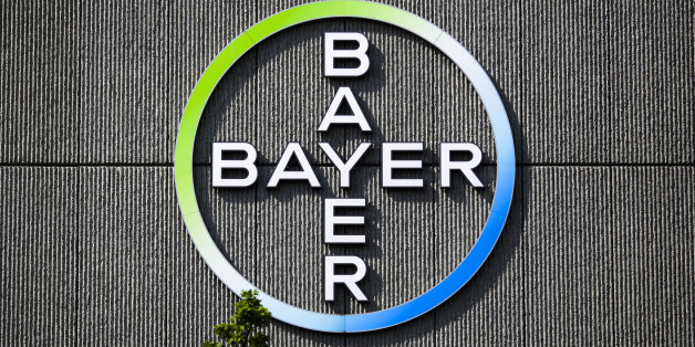 FILE - In this May 23, 2016, file picture the Bayer AG corporate logo is displayed on a building of the German drug and chemicals company in Berlin, Germany. German drug and farm chemical company Bayer AG said it has signed a deal Wednesday, Sept. 14, 2016, to acquire seed and weed-killer company Monsanto for about $66 billion in cash. (AP Photo/Markus Schreiber)