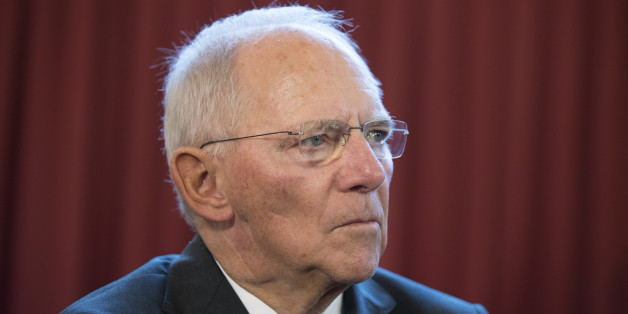 Wolfgang Schaeuble, Germany's finance minister, center, pauses whilst speaking to journalists as he arrives for a meeting of European finance ministers in Bratislava, Slovakia, on Friday, Sept. 9, 2016. German Chancellor Angela Merkel said that European leaders meeting in Bratislava this month need to be ambitious in seeking to map out a future for the European Union after the departure of the U.K. Photographer: Jasper Juinen/Bloomberg via Getty Images
