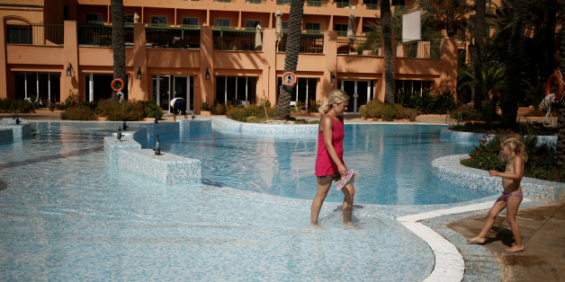 "A Russian tourist walks in a swimming pool of El Ksar hotel in Sousse, Tunisia June 24, 2016. REUTERS/ Zohra Bensemra        SEARCH ""ZOHRA SOUSSE"" FOR THIS STORY. SEARCH ""THE WIDER IMAGE"" FOR ALL STORIES"