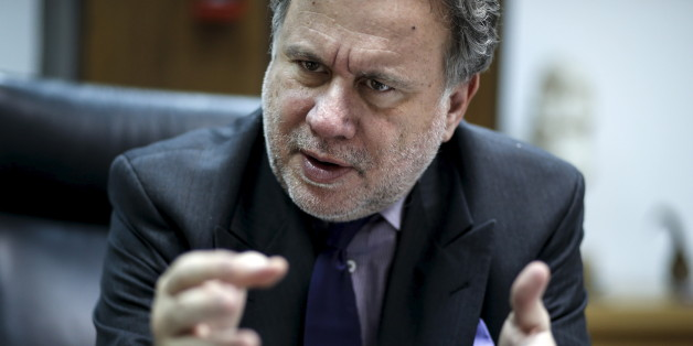 Greek Labour Minister George Katrougalos gestures during an interview with Reuters at his office at the ministry in Athens, Greece, February 24, 2016. Greece's left-led government will not cut pensions again even if its international lenders demand it, the country's labour minister told Reuters on Thursday, saying the income of the weak will be protected.  REUTERS/Alkis Konstantinidis