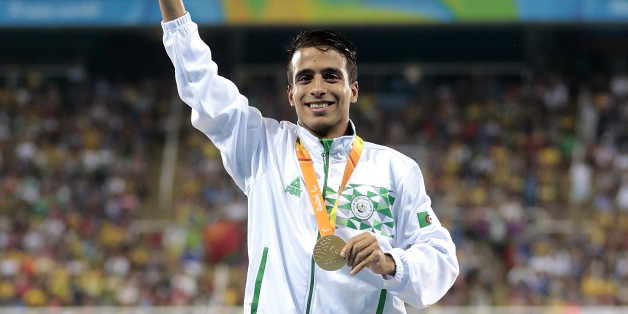 RIO DE JANEIRO, BRAZIL - SEPTEMBER 11: Gold medalist Abdellatif Baka of Algeria celebrate on the podium at the medal ceremony for the Men's 1500m - T13 Final during day 4 of the Rio 2016 Paralympic Games at the Olympic Stadium on September 11, 2016 in Rio de Janeiro, Brazil. (Photo by Alexandre Loureiro/Getty Images)