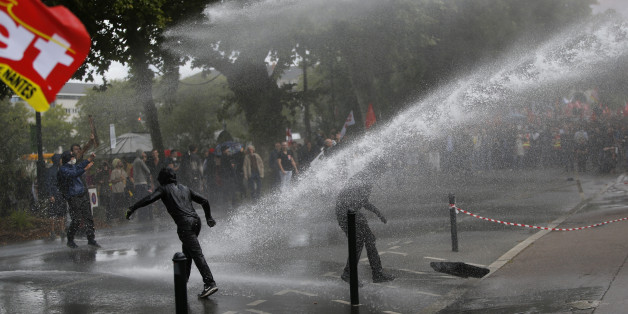 Demonstrators are sprayed by a water canon during clashes with French riot police at a march in Nantes, western France, to demonstrate against the new French labour law, September 15, 2016. REUTERS/Stephane Mahe