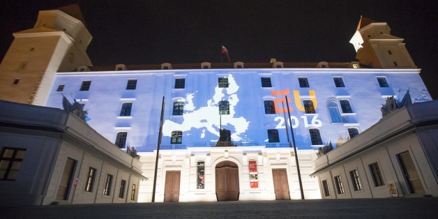 The Netherlands EU Presidency 2016 logo projected onto walls of Bratislava Castle in Bratislava, Slovakia, Thursday, June 30, 2016. Slovakia takes over the European Union's presidency on Friday determined to help reconnect the EU with its citizens and put decision-making back in the hands of Europe's nations as the bloc reels from Britain's vote to leave. (AP Photo/Bundas Engler)
