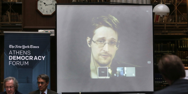 National Security Agency leaker Edward Snowden speaks via video link during the Athens Democracy Forum, organised by the New York Times, at the National Library in Athens, on Friday, Sept. 16, 2016. Snowden, in exile in Moscow after leaking U.S. National Security Agency documents, said Friday he intends to vote in the U.S. presidential election, but did not say which candidate he favors.  (Kostas Baltas, InTime Sports via AP)
