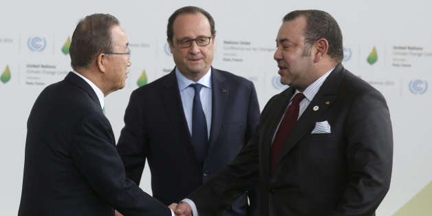 United Nations Secretary General Ban Ki-moon (L) and French President Francois Hollande (C) welcome Morocco's King Mohammed VI as he arrives for the opening day of the World Climate Change Conference 2015 (COP21) at Le Bourget, near Paris, France, November 30, 2015.       REUTERS/Christian Hartmann