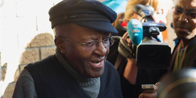 South African anti-apartheid activist and Nobel Peace Laureate Archbishop Desmond Tutu speak to journalists after casting his vote in the South African local government elections at Milnerton High School in Cape Town on August 3, 2016. 