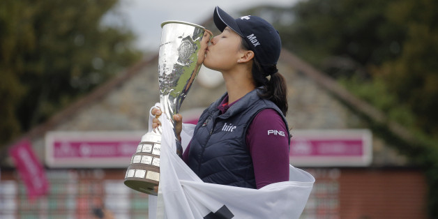 In Gee Chun of South Korea celebrates with her trophy after winning the Evian Championship women's golf tournament in Evian, eastern France, Sunday, Sept. 18, 2016. (AP Photo/Laurent Cipriani)