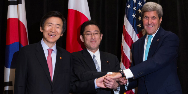 Minister of Foreign Affairs Yun Byung-se of South Korea (L), Minister of Foreign Affairs Fumio Kishida of Japan, and U.S. Secretary of State John Kerry (R) join hands during a meeting between the three leaders in New York, U.S. September 18, 2016. During the meeting, Kerry and ministers from Japan and the Republic of Korea discussed North Korea's nuclear tests in the region. REUTERS/Kevin Hagen/POOL