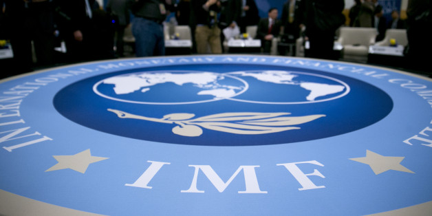 The International Monetary and Financial Committee (IMFC) logo is seen at an IFMC meeting during the International Monetary Fund (IMF) and World Bank Group Spring Meetings in Washington, D.C., U.S., on Saturday, April 20, 2013. The IMF's Managing Director said the euro area has the only central bank with enough leeway to take more measures to boost growth as low interest rates fail to trickle down to the region's economy. Photographer: Andrew Harrer/Bloomberg via Getty Images