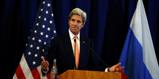 U.S. Secretary of State John Kerry gestures during a press conference with Russian Foreign Minister Sergei Lavrov following their meeting in Geneva, Switzerland about the crisis in Syria late September 9, 2016. REUTERS/Kevin Lamarque