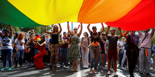 Participants hold a rainbow flag during an annual LGBT (Lesbian, Gay, Bisexual and Transgender) pride parade in Belgrade, Serbia September 18, 2016.  REUTERS/Marko Djurica