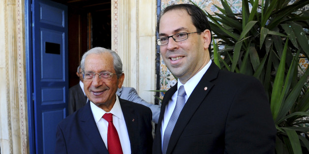 Newly named Tunisian Prime Minister Youssef Chahed Youssef, right, meets Mohamed Ennaceur, head of the Parliament in Tunis, Friday Aug. 26, 2016 ahead of a confidence vote. (AP Photo/Riadh Dridi)