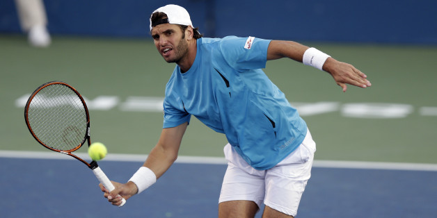 Malek Jaziri, of Tunisia, returns a shot to Kevin Anderson, of South Africa, during a semifinal at the Winston-Salem Open tennis tournament in Winston-Salem, N.C., Friday, Aug. 28, 2015. (AP Photo/Gerry Broome)