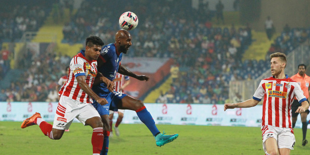 MUMBAI, INDIA - NOVEMBER 1: Captain of Mumbai City FC Anelka trying to go past of Atletico de Kolkata defense during Indian Super League match at DY Patil stadium on November 1, 2015 in Navi Mumbai, India. (Photo by Arijit Sen/Hindustan Times via Getty Images)