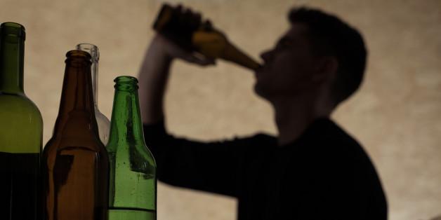 Alcoholism among young people - teenager drinking beer