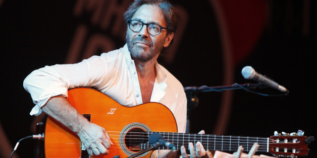 U.S. guitarist Al Di Meola performs with his World Sinfonia band during the 22nd Malta Jazz Festival in Valletta, July 19, 2012. REUTERS/Darrin Zammit Lupi (MALTA - Tags: ENTERTAINMENT SOCIETY) MALTA OUT. NO COMMERCIAL OR EDITORIAL SALES IN MALTA